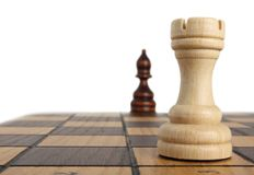Rook and bishop on chessboard. Rook opposite the bishop on a chess board Royalty Free Stock Photo