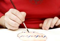 Rookie artist. She paints a watercolors paints Stock Images