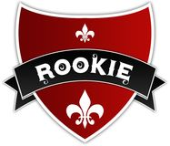 ROOKIE on black ribbon above red shield. Stock Image