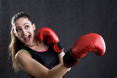 Rookie boxer girl. Portrait of rookie boxer girl afraid to take punch in face. Concept of starting going in for sports Royalty Free Stock Photography