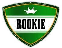ROOKIE written on green shield with crown. Stock Photos