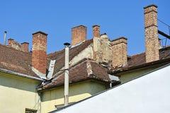 Rookstapels op de daken Royalty-vrije Stock Afbeelding