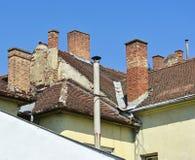 Rookstapels op de daken Stock Fotografie
