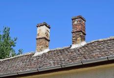 Rookstapels op het dak Royalty-vrije Stock Afbeeldingen