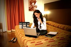 Room. A woman on the bed with notebook in a room hotel Royalty Free Stock Photos