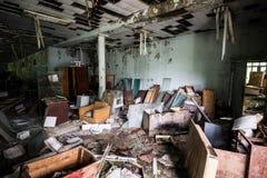 Room in abandoned community center in Pripyat. Room with debris in abandoned community center in Pripyat, Chernobyl, Ukraine royalty free stock photography
