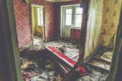 Room in abandoned house, habitation of homeless people. Room in abandoned house, broken furniture on the floor, habitation of homeless people royalty free stock image