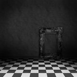 Room with black and white checker on the floor. Empty, dark, psychedelic room with black and white checker on the floor and empty black frame. Nightmare or dream Stock Image