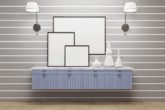 Room with blue drawers, lamps, posters, gray wall. Room with white stripes on gray wall. There are framed posters standing on a blue set of drawers. 3d rendering Royalty Free Stock Photos