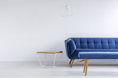 Room with blue sofa and bench Royalty Free Stock Image