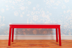 Room with blue vintage wall paper and red bench Stock Photography