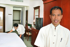 Room boy or housekeeping. Photograph of room boy or housekeeping at work stock image