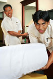 Room boy or housekeeping in action. Photograph of two room boy at work royalty free stock photo