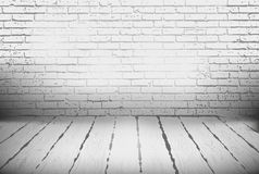 Room with a brick wall and wooden floor Royalty Free Stock Photo