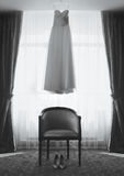 Room of the bride, wedding dress and shoes, chair Royalty Free Stock Photo