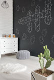 Room with cactus and dresser. Room with creative wall decoration, cactus and dresser royalty free stock photography