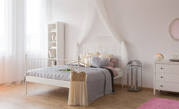 Room with canopy bed. White room with canopy bed, bookshelf and dresser stock photos