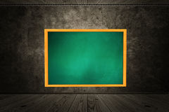 Room with chalkboard of green color Stock Images