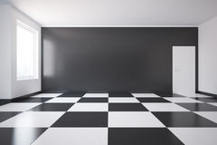 Room with chess pattern on floor Stock Image