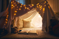 Room of children empty tent lodge in the evening. Before going to bed Royalty Free Stock Image