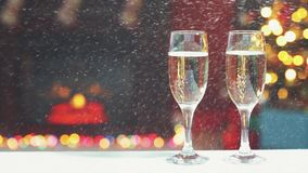 Room for Christmas. Room decorated for Christmas with two glasses of champagne stock video