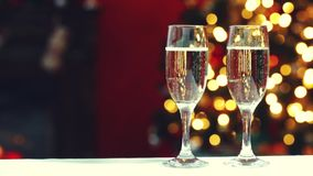 Room for Christmas. Room decorated for Christmas with two glasses of champagne stock video footage