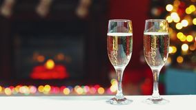 Room Christmas. Room decorated for Christmas with two glasses of champagne stock video