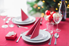Room with christmas tree and decorated table Royalty Free Stock Images