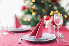 Room with christmas tree and decorated table Royalty Free Stock Photos