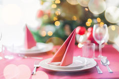 Room with christmas tree and decorated table Royalty Free Stock Photography