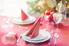 Room with christmas tree and decorated table Stock Photos