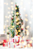 Room with christmas tree and presents background. Holidays, celebration and home concept - living room with christmas tree and presents background royalty free stock images