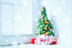 Room with christmas tree and presents background. Holidays, celebration and home concept - living room with christmas tree and presents background stock image