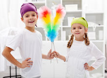 Room cleaning taskforce - kids with dust brushes Royalty Free Stock Images