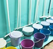 Room with cleaning tools, buckets, mops domestic stock image