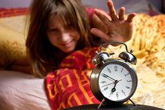 Room clock bed lazy sleep wake Stock Image