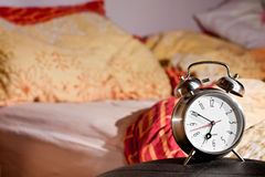Room clock bed lazy sleep wake Royalty Free Stock Photography
