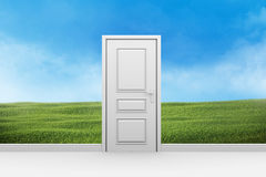 Room with closed door and lawn of green grass Stock Photos