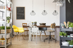 Room with communal table. Chairs, industrial regale and cart Royalty Free Stock Photos