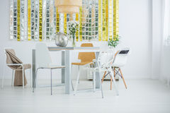 Room with communal table. Chairs and wall decor Stock Photography