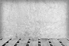 Room with a concrete wall and wooden floors Royalty Free Stock Photography