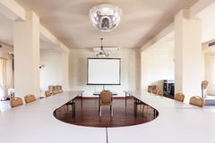 Room with conference table Stock Photos
