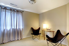Room corner with two modern chairs and table Stock Photography