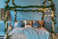 Room, decorated for christmas with: bed, tree with presents and toys and lights. royalty free stock images