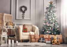 Room decorated for Christmas. Merry Christmas and Happy Holidays! A beautiful living room decorated for Christmas stock photo