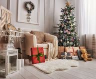 Room decorated for Christmas. Merry Christmas and Happy Holidays! A beautiful living room decorated for Christmas royalty free stock photo