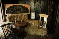 Western Room With Hay Bales And Clocks royalty free stock image