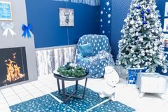 Room decoration for the New Year with a Christmas tree, toys and a table stock photography
