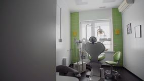 Room with dental green chair and medical equipment stock video