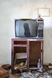 Room destroyed with furniture and old television Stock Images